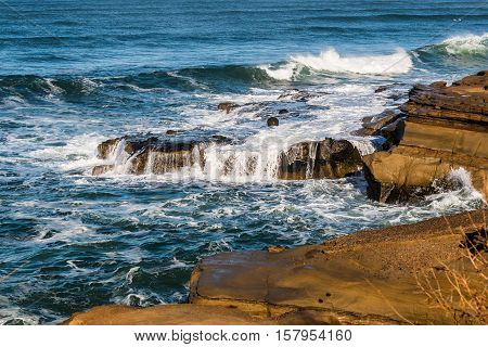 Waves and rock formations at Sunset Cliffs in San Diego, California.