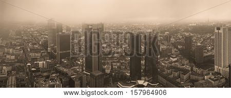 Frankfurt European financial capital skyline in fog. Toned Image