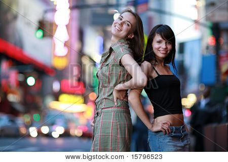 Two beautiful girls posing in New York City. Shallow DOF.