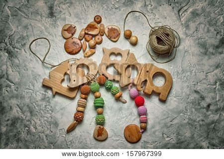 Children's Wooden Toys, And A Coil Of Rope With Wooden Parts For Their Manufacturing. Needlework.