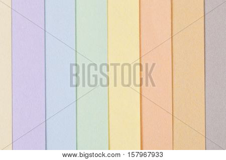 Background of pastel colors paper parallel vertical stripes place for text