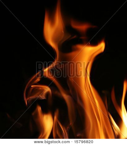 Fire flames over black background texture