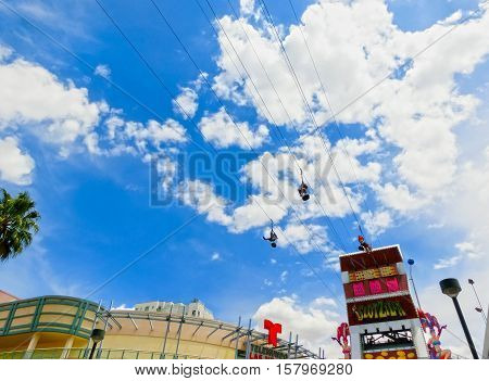 Las Vegas, United States of America - May 07, 2016: The people at the SlotZilla zip line attraction at the Fremont Street Experience at Las Vegas, USA on May 07, 2016