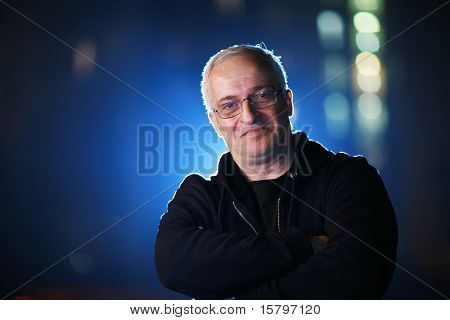 Portrait of a senior man at night. Shallow DOF.