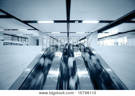 Many people using escalator, blurred motion