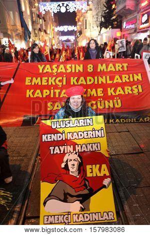 ISTANBUL,TURKEY-MARCH 8: Unidentified woman in purple costume celebrates international women's day on March 8,2012,in Istanbul,Turkey