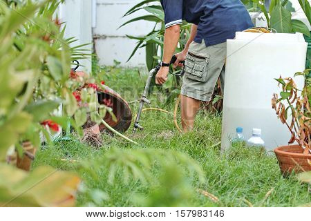 Technicians Compressed Chemicals Into The Soil For Attacted Termite Queen.
