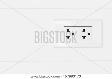 White plugs on white wood wall plug copy space plug socket plug electric plug outlet plug switch plug backdrop plug background.