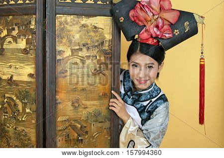 Chinese woman peering around a dressing protector