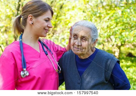 Picture of a senior woman with her caregiver