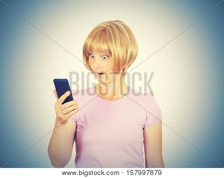 Closeup Portrait Anxious  Young Woman Looking At Phone Seeing Bad News.