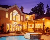 image of hot-tub  - Nice exterior of luxoury home taken at sunset with hot tub - JPG