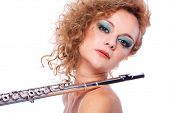 image of transverse  - Portrait of a woman playing transverse flute - JPG