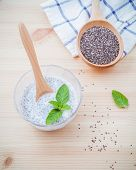 Постер, плакат: Nutritious Chia Seeds Museli And Peppermint Leaves With Wooden Spoon For Diet Foods Ingredients Set