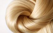 foto of hair streaks  - long blond human hair close - JPG