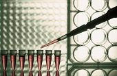 Microtubes and micropipet lab test. Toned Image poster