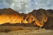stock photo of mountain-range  - The mountains brightly shined by the sun about Eilat in Israel - JPG