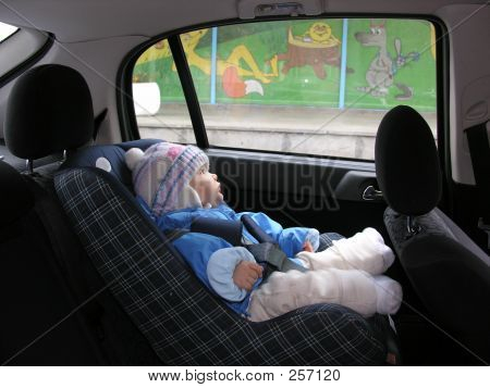 Baby In Car With Dreams In Window