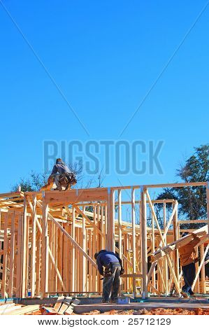 Workers on New Home Construction