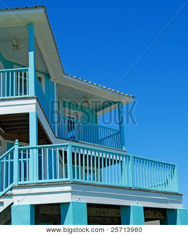 Bright blue Coastal Home with Balconies