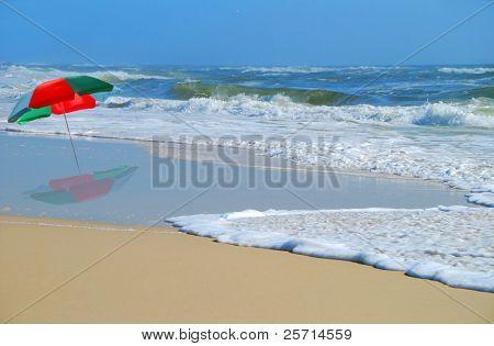 Umbrella Facing High Tide