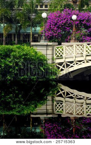 Ornate Bridge Over Still Pond