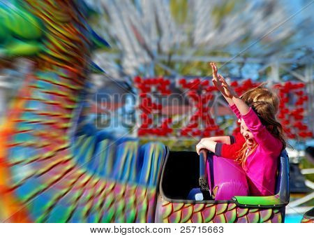Happy Girl on Fair Rollercoaster