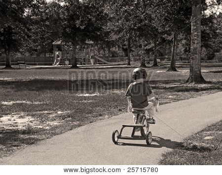 Toddler Boy Riding Tricycle Wearing Safety Helmet