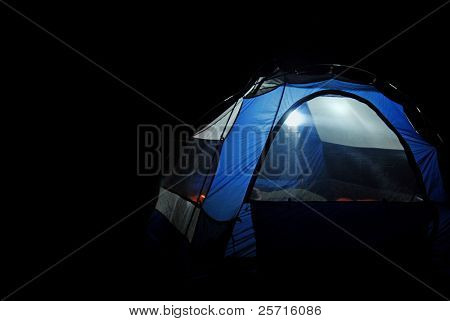 Tent In the Dark with Lantern Lit Inside