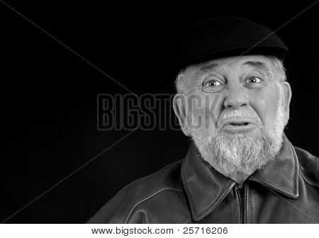 Older Caucasian Male with Beard and Very Expressive Face