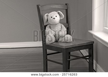 Well Loved Bear on Wooden Chair by Window