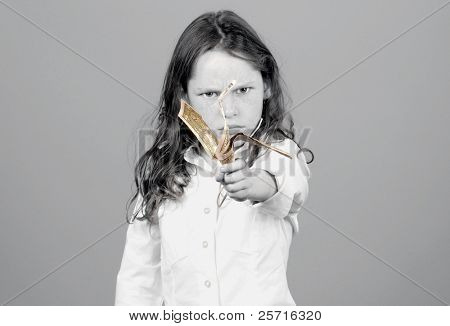 Young Girl Holding Out Crumpled Dollar Bills