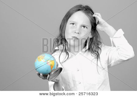 Young Girl Looking Confused While Holding Globe