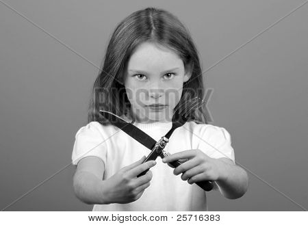Young Girl Hold Fork and Knife in an X or Crossed Position