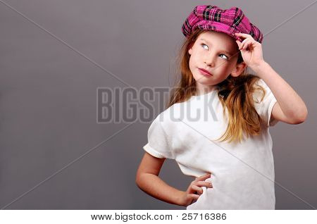 Cute Young Girl in Pink Plaid Cap