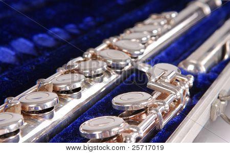 Silver flute in blue velvet lined carrying case