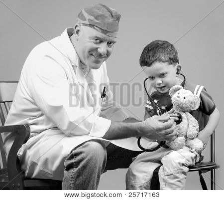 Physician Examining Child and His Bear
