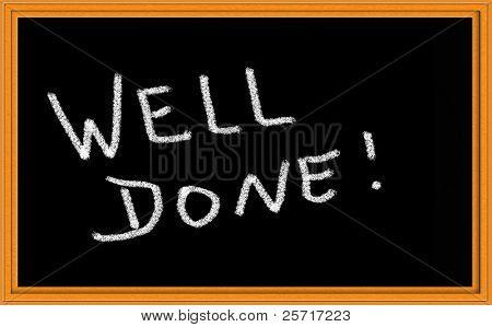 Well Done written with chalk on blackboard