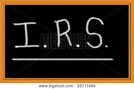 I.R.S. written in chalk on blackboard