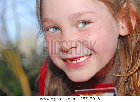 Happy Freckle Face Toothless Girl