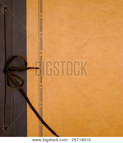 Antique photo album cover with string tie for binding