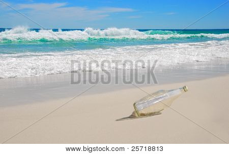 Beautiful beach with mysterious message in the bottle