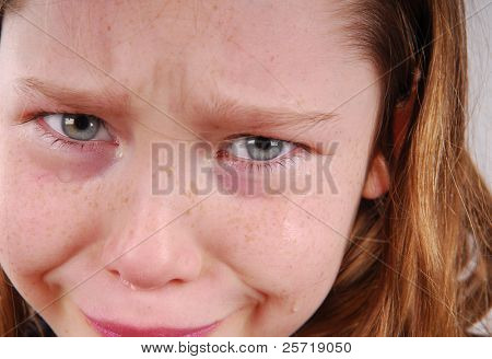Sad young girl with tears