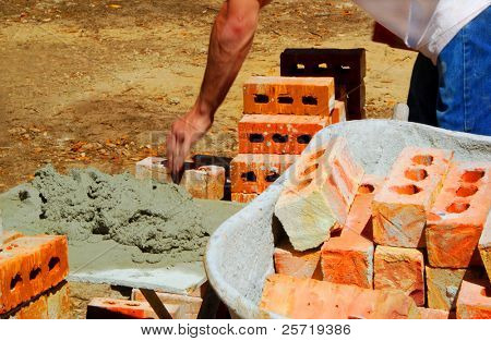 Fast moving brick master preparing cement for mortar