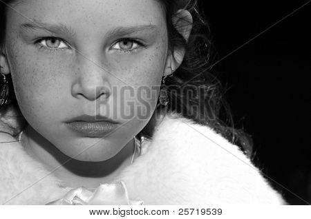 Young girl looking serious wearing fur stole