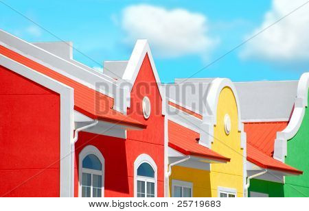 Brightly colored townhomes under pretty sky