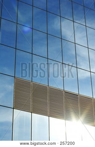 Reflection Of Sky In Office Block Window