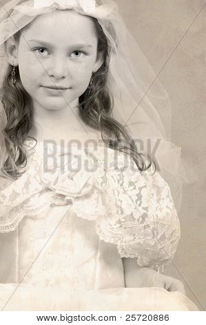 Young girl in formal gown and veil with antiqued overlay