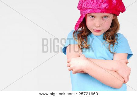 Young girl wearing cap with strong attitude