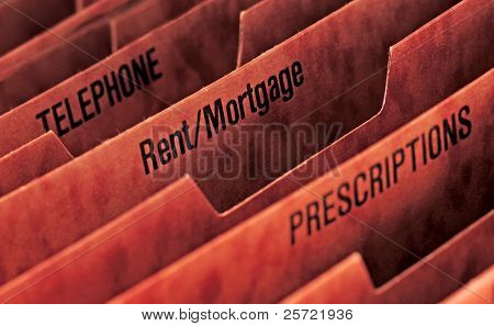 File folder with rent and mortgage slots